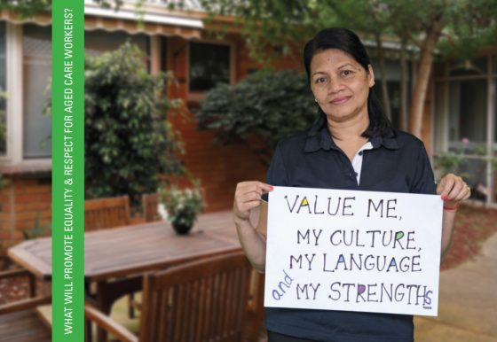 Image of a smiling migrant woman working in aged care holding a sign that reads 'Value me, my culture, my language and my strengths'