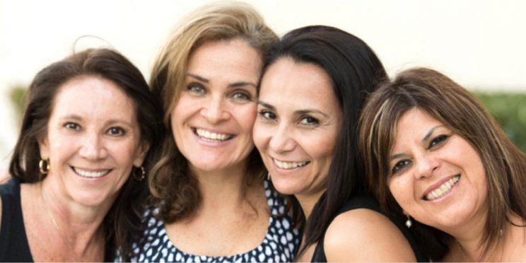Four women smiling
