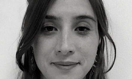 Image of Bibiana Huggins, a young woman smiling at the camera